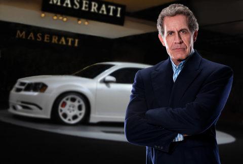 photo of auto executive with a car