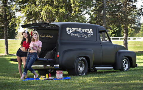 fashion models posing by truck picnic
