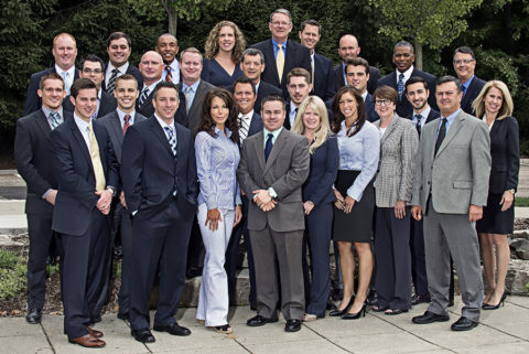 team photo of a group of business people in farmington hills