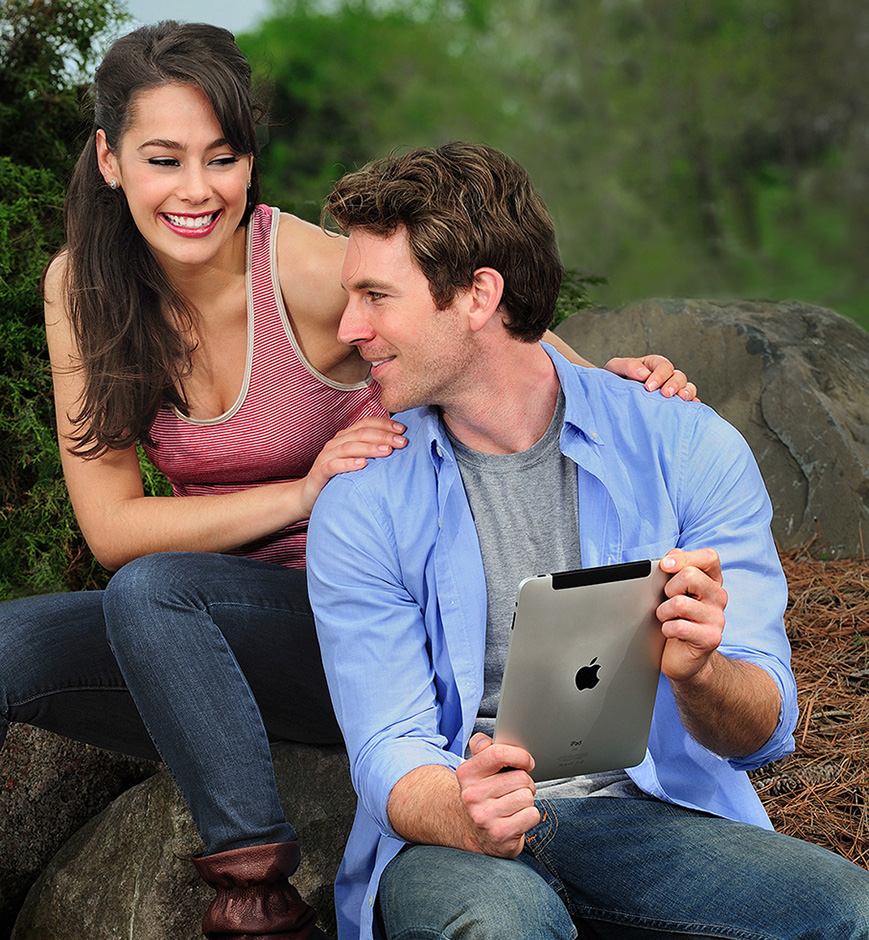 young couple looking at an ipad
