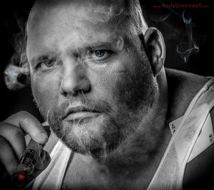 movie actor smoking a cigar in a photo studio