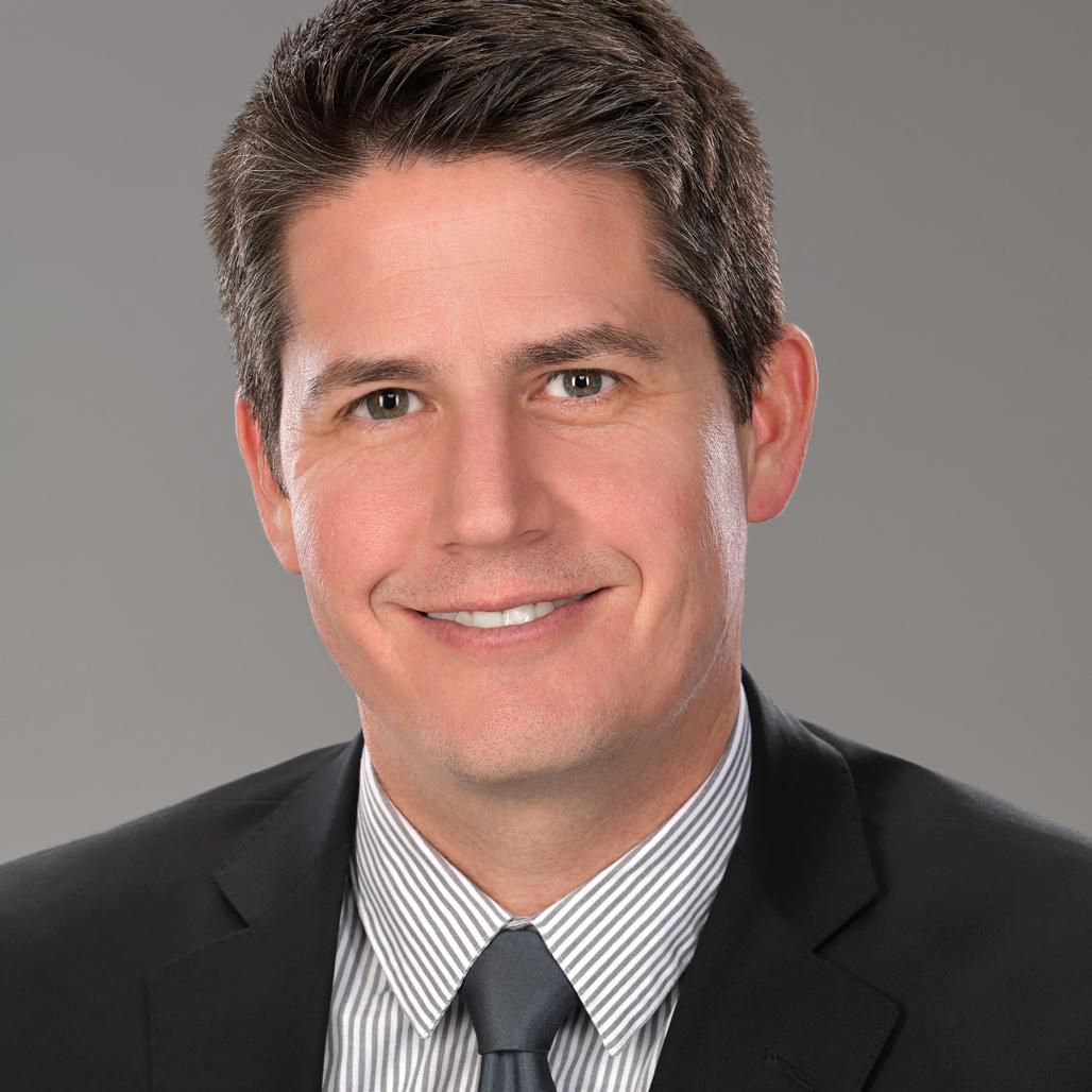 headshot of a banking executive