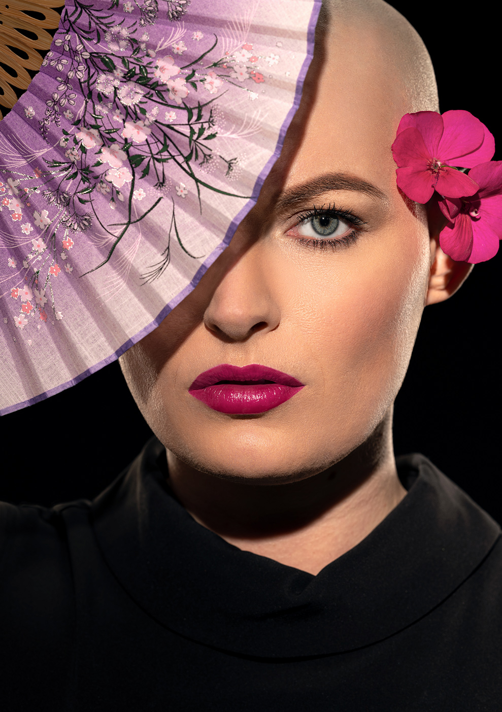 headshot of a bald model actress